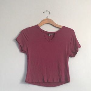 Cranberry colored shirt with a peep hole